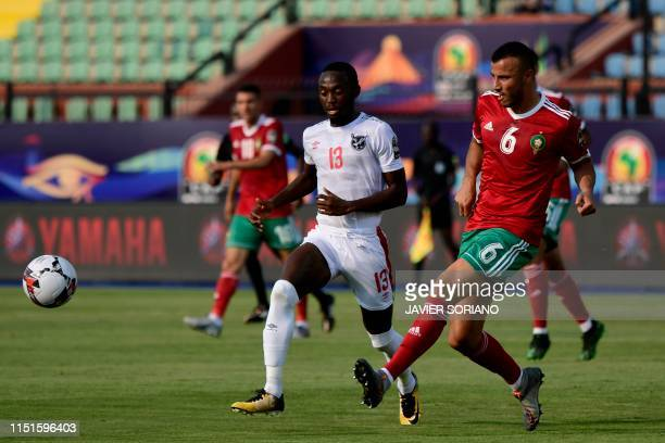 Morocco's defender Romain Saiss passes the ball as he is marked by Namibia's forward Peter Shalulile during the 2019 Africa Cup of Nations football...