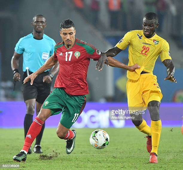 Morocco's Dirar vies for the ball against Togo's Bebou during the African Cup of Nations Group C soccer match between Morocco and Togo at the Stade...