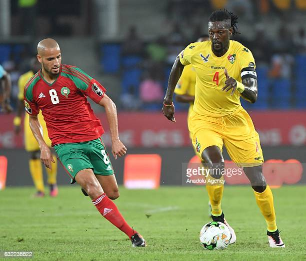 Morocco's El Ahmadi vies for the ball against Togo's Adebayor during the African Cup of Nations Group C soccer match between Morocco and Togo at the...