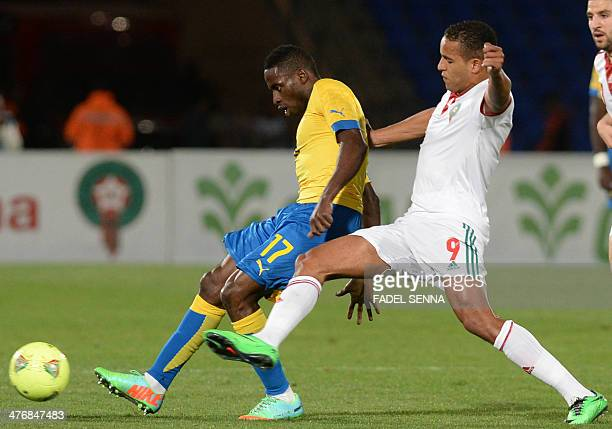 Morocco's El Arabi Youssef fights for the ball with Gabon's Andre Biyogho Poko during an international friendly football match in Marrakech on March...