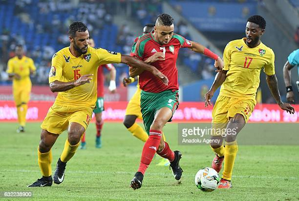 Morocco's EnNesyri vies for the ball against Togo's Romao and Gakpe during the African Cup of Nations Group C soccer match between Morocco and Togo...