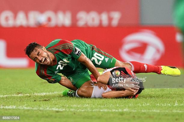 Morocco's forward Aziz Bouhaddouz and Egypt's midfielder Tarek Hamed react after colliding during the 2017 Africa Cup of Nations quarterfinal...