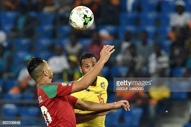 Morocco's forward Aziz Bouhaddouz challenges Togo's midfielder Alaixys Romao during the 2017 Africa Cup of Nations group C football match between...