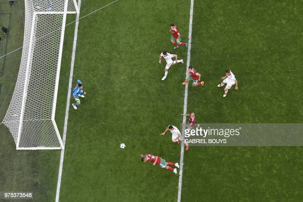 TOPSHOT Morocco's forward Aziz Bouhaddouz scores an own goal during the Russia 2018 World Cup Group B football match between Morocco and Iran at the...