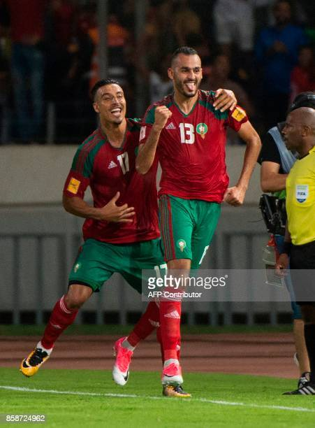Morocco's forward Khalid Boutaib celebrates his goal with teammate Nabil Dirar during their FIFA World Cup 2018 Group C football match between...