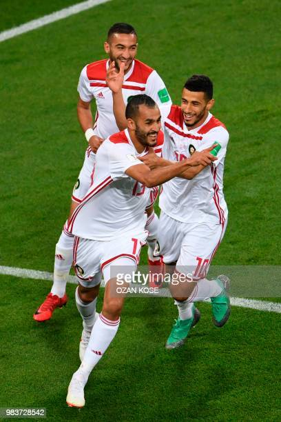 TOPSHOT Morocco's forward Khalid Boutaib celebrates with Morocco's midfielder Younes Belhanda after scoring the opener during the Russia 2018 World...