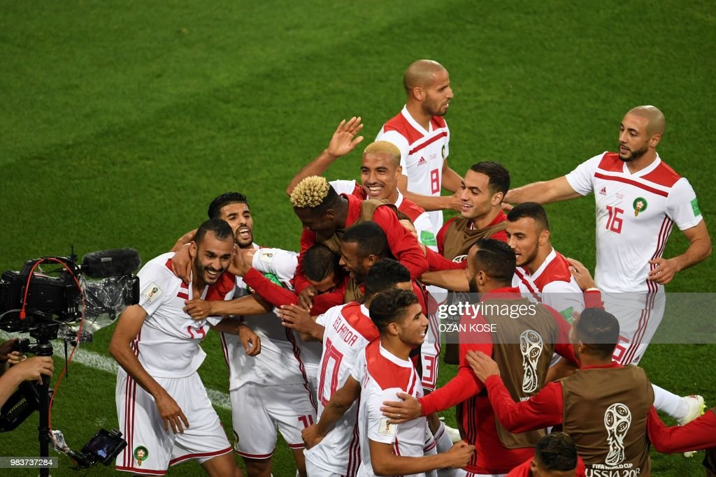 TOPSHOT - Morocco's forward Khalid Boutaib (L) celebrates with teammates after scoring the opener during the Russia 2018 World Cup Group B football match between Spain and Morocco at the Kaliningrad Stadium in Kaliningrad on June 25, 2018. (Photo by OZAN KOSE / AFP) / RESTRICTED