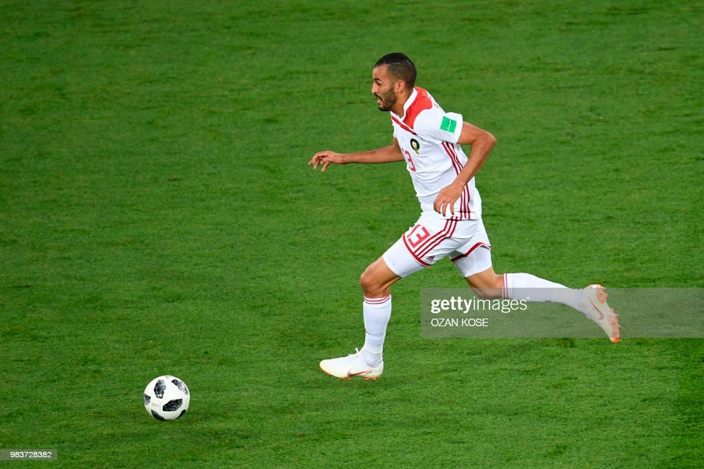 Morocco's forward Khalid Boutaib drives the ball on his way to score the opener during the Russia 2018 World Cup Group B football match between Spain and Morocco at the Kaliningrad Stadium in Kaliningrad on June 25, 2018. (Photo by OZAN KOSE / AFP) / RESTRICTED