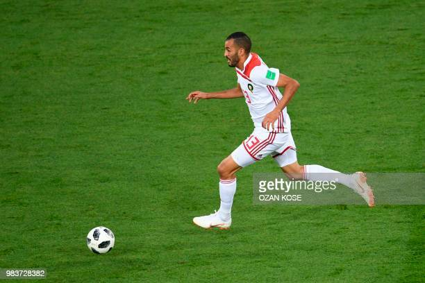 Morocco's forward Khalid Boutaib drives the ball on his way to score the opener during the Russia 2018 World Cup Group B football match between Spain...