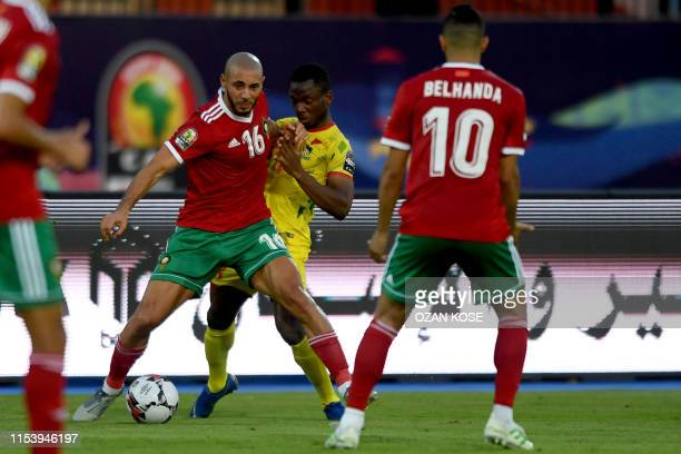 Morocco's forward Nordin Amrabat fights for the ball with Benin's midfielder Mama Seibou during the 2019 Africa Cup of Nations Round of 16 football...