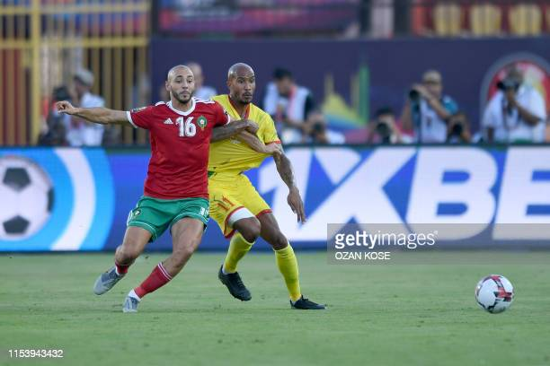 Morocco's forward Nordin Amrabat fights for the ball with Benin's defender Emmanuel Imorou during the 2019 Africa Cup of Nations Round of 16 football...