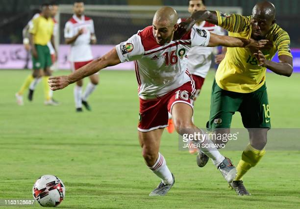 Morocco's forward Nordin Amrabat fights for the ball with South Africa's defender Sifiso Hlanti during the 2019 Africa Cup of Nations Group B...