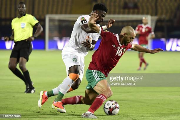 Morocco's forward Nordin Amrabat is marked by Ivory Coast's defender Serge Aurier during the 2019 Africa Cup of Nations Group D football match...
