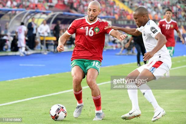 Morocco's forward Nordin Amrabat is marked by Namibia's defender Riaan Hanamub during the 2019 Africa Cup of Nations football match between Morocco...