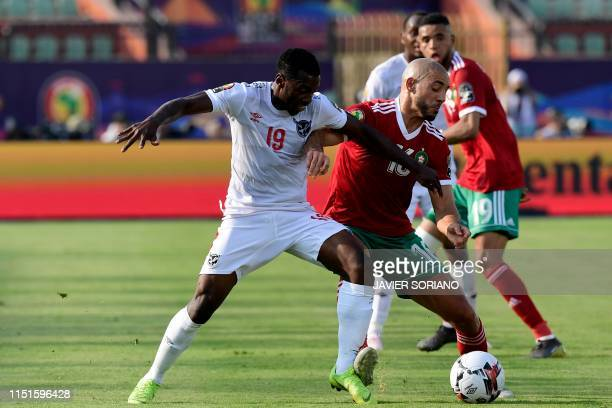 Morocco's forward Nordin Amrabat is marked by Namibia's midfielder Petrus Shitembi during the 2019 Africa Cup of Nations football match between...