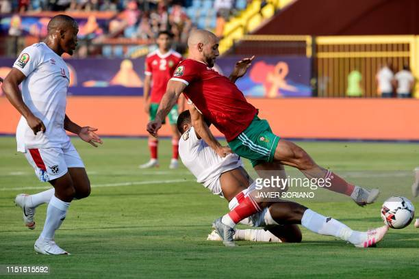 Morocco's forward Nordin Amrabat is tackled by Namibia's defender Ryan Nyambe during the 2019 Africa Cup of Nations football match between Morocco...