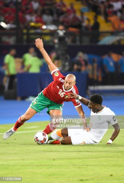 Morocco's forward Nordin Amrabat vies for the ball with Ivory Coast's defender Serge Aurier during the 2019 Africa Cup of Nations Group D football...