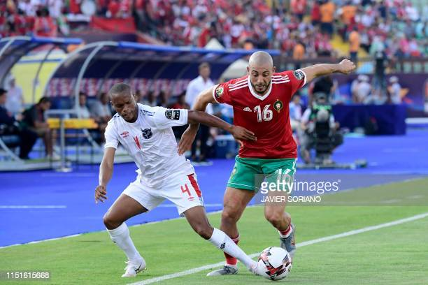 Morocco's forward Nordin Amrabat vies for the ball with Namibia's defender Riaan Hanamub during the 2019 Africa Cup of Nations football match between...