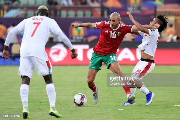 Morocco's forward Nordin Amrabat vies for the ball with Namibia's midfielder Marcel Papama during the 2019 Africa Cup of Nations football match...