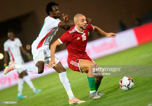 Morocco's forward Nordin Amrabat vises for the ball with Burkina Faso's forward Jonathan Pitroipa during the friendly football match between Morocco...