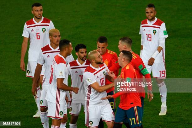 Morocco's forward Noureddine Amrabat argues with Spain's forward Iago Aspas during the Russia 2018 World Cup Group B football match between Spain and...