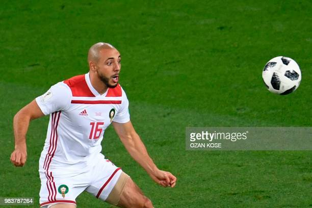 Morocco's forward Noureddine Amrabat eyes the ball during the Russia 2018 World Cup Group B football match between Spain and Morocco at the...