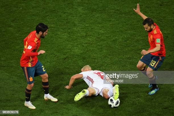 Morocco's forward Noureddine Amrabat lies between Spain's defender Dani Carvajal and Spain's defender Jordi Alba during the Russia 2018 World Cup...
