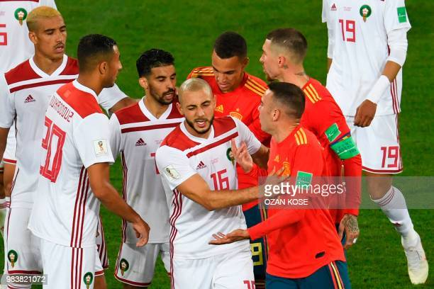 Morocco's forward Noureddine Amrabat reacts as players clash during the Russia 2018 World Cup Group B football match between Spain and Morocco at the...
