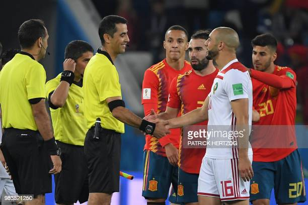 Morocco's forward Noureddine Amrabat shakes hands with Uzbek referee Ravshan Irmatov at the end of the Russia 2018 World Cup Group B football match...