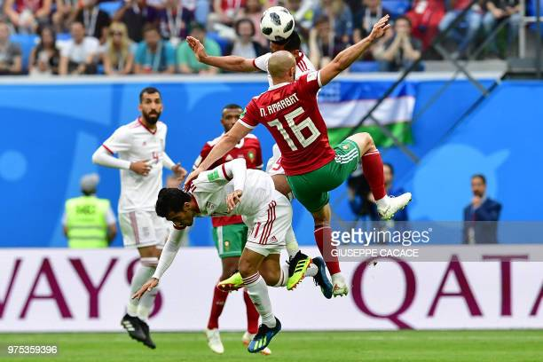 Morocco's forward Noureddine Amrabat vies for the ball with Iran's forward Vahid Amiri and Iran's midfielder Omid Ebrahimi during the Russia 2018...