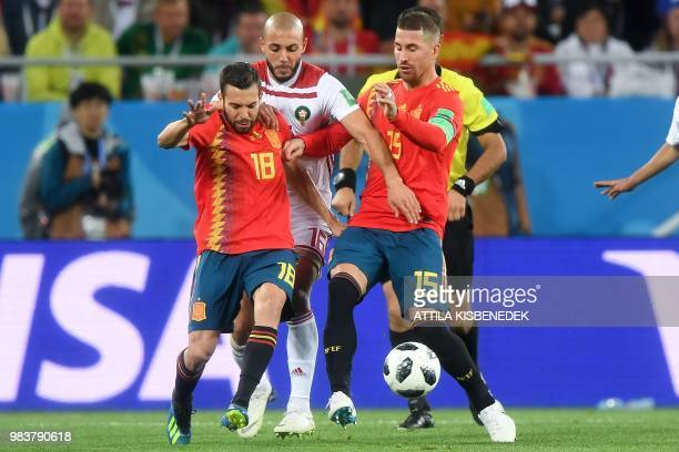Morocco's forward Noureddine Amrabat vies with Spain's defender Jordi Alba and Spain's defender Sergio Ramos during the Russia 2018 World Cup Group B...