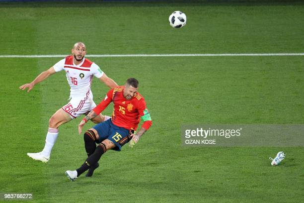 Morocco's forward Noureddine Amrabat vies with Spain's defender Sergio Ramos during the Russia 2018 World Cup Group B football match between Spain...