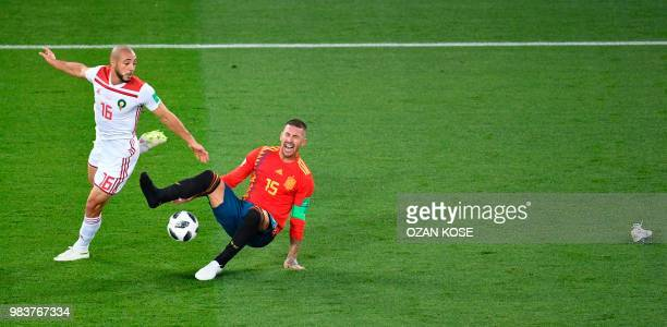 Morocco's forward Noureddine Amrabat vies with Spain's defender Sergio Ramos who looses a sneaker during the Russia 2018 World Cup Group B football...