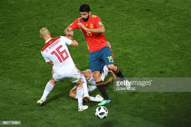 Morocco's forward Noureddine Amrabat vies with Spain's forward Diego Costa during the Russia 2018 World Cup Group B football match between Spain and...