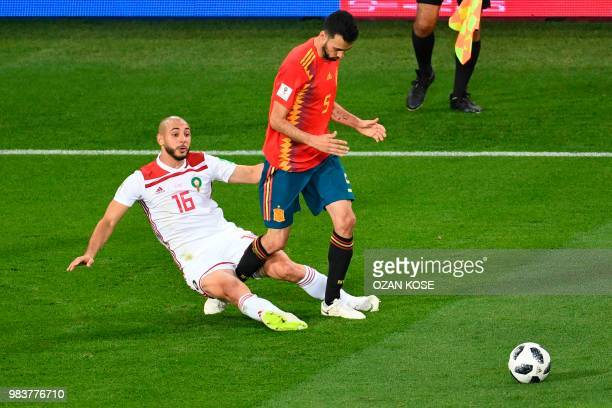 Morocco's forward Noureddine Amrabat vies with Spain's midfielder Sergio Busquets during the Russia 2018 World Cup Group B football match between...