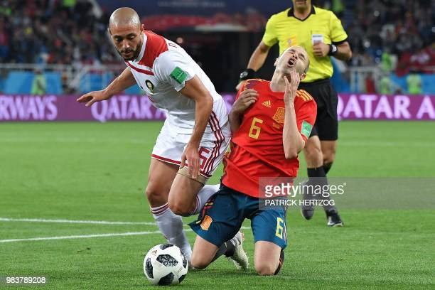 Morocco's forward Noureddine Amrabat vies with Spain's midfielder Andres Iniesta during the Russia 2018 World Cup Group B football match between...