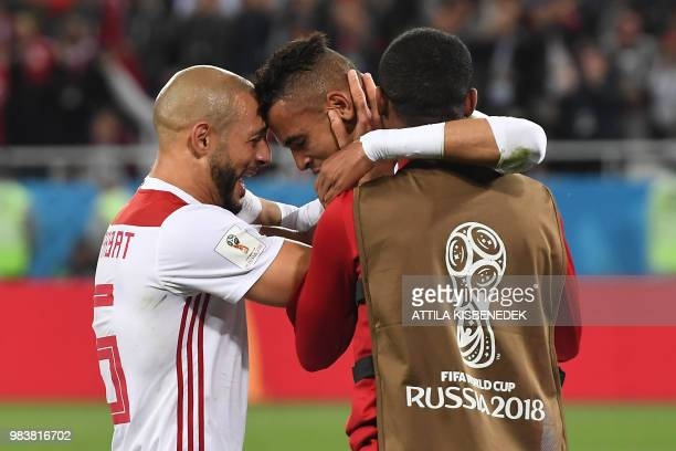 TOPSHOT Morocco's forward Youssef EnNesyri celebrates a goal with Morocco's forward Noureddine Amrabat during the Russia 2018 World Cup Group B...