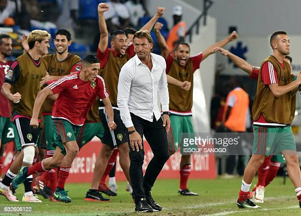 Morocco's French coach Herve Renard reacts as Morocco's players celebrate at the end of the 2017 Africa Cup of Nations group C football match between...