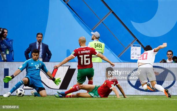 Morocco's goalkeeper Munir Mohand Mohamedi blocks a shot on goal by Iran's forward Sardar Azmoun during the Russia 2018 World Cup Group B football...