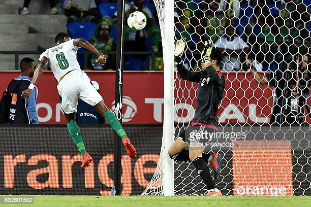 TOPSHOT Morocco's goalkeeper Munir Mohand Mohamedi prepares to block a shot on goal by Ivory Coast's forward Salomon Kalou during the 2017 Africa Cup...