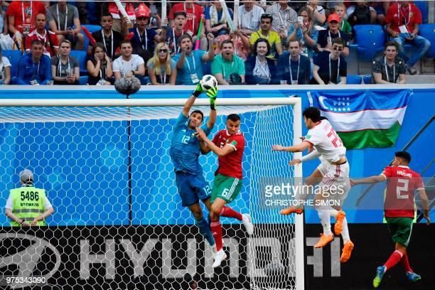 Morocco's goalkeeper Munir Mohand Mohamedi stops a header by Iran's forward Sardar Azmoun during the Russia 2018 World Cup Group B football match...