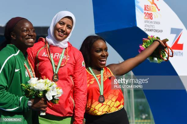 Morocco's gold medalist Soukaina Zakour is flanked by silver medalist Nigeria's Temilola Ogunrinde and Congo's bronze medalist Jennifer Bawsikita at...