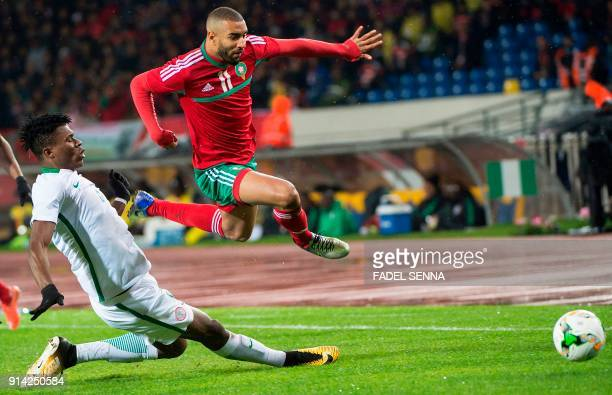 Morocco's Ismail El Haddad vies for the ball with Nigeria's Stephen Eze during the final football match in the African Nations Championship between...