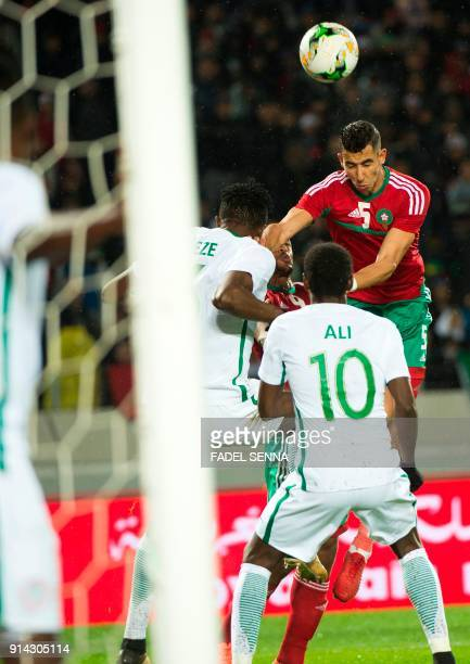 Morocco's Jawad El Yamiq heads the ball against Nigeria's Rabiu Ali during the African Nations Championship football final between Morocco and...