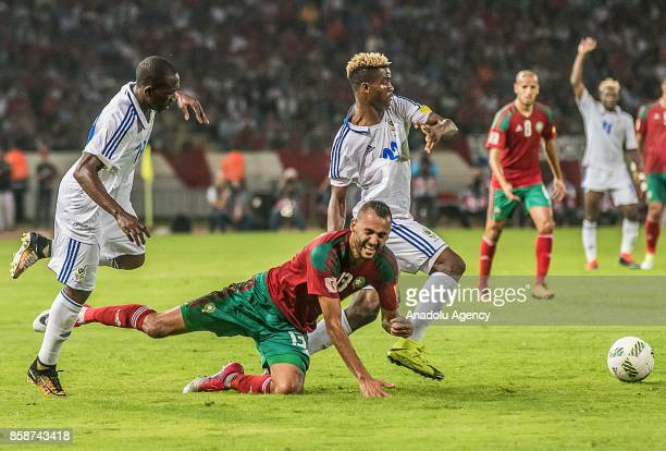 Morocco's Khalid Boutaib vies for the ball with Gabon's Didier Ibrahim N'Dong during their FIFA World Cup 2018 Group C football match between Morocco...