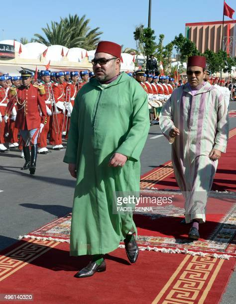 Morocco's King Mohammed VI and his brother Prince Moulay Rachid arrive at a ceremony to sign conventions for projects in the region of the Western...
