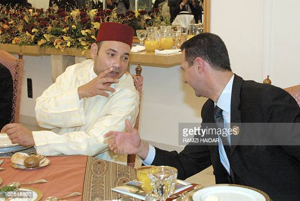 Morocco's King Mohammed VI chats with Syrian President Bashar alAssad at the start of a dinner given in honor of the leaders attending the Arab...