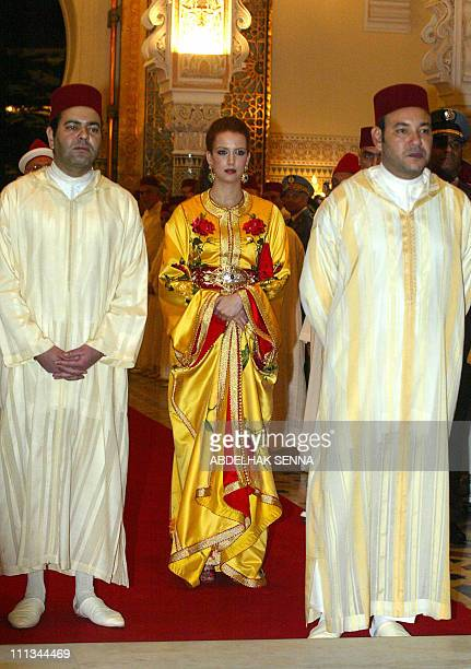 Morocco's King Mohammed VI his wife Princess Lalla Salma and the king's brother Prince Moulay Rachid arrive for a dinner with Chinese President Hu...