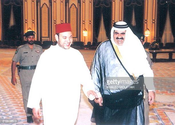 Morocco's King Mohammed VI is received by Qatari leader Sheikh Hamad bin Khalifa alThani in Doha late 05 June 2002 The Moroccan monarch on a regional...
