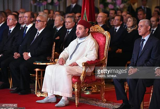 Morocco's King Mohammed VI listens to a speech from Carlos Tavares the general director of PSA Peugeot Citroen at the royal palace of Rabat on June...